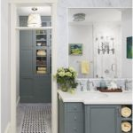 A 20-inch-wide mosaic runner connects the bath to the walk-in closet. A built-in...
