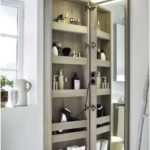 A Comfortable Storage Piece With A Mirror On The Door Is A Popular Bathroom Option Diyundhaus.com