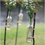 Use flowers and lights to create a simple but gorgeous makeshift aisle.