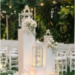 Vintage wedding decoration with flowers and lanterns