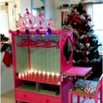 Lilys Princess Closet with vanity, made from a entertainment center.