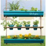 hanging rain gutter planter with herb gardensuch a great way to decorate for spr...