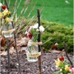 Cute decoration idea for a garden party with jam jars and sticks - glass ideas