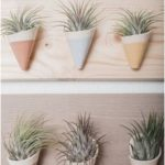 These ceramic hanging wall planters update your home decor and bring instant pla...