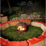 Outdoor fireplace garden design bales of straw